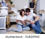 happy couple looking through... | Shutterstock . vector #51820942