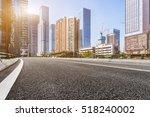 empty urban road through modern ... | Shutterstock . vector #518240002