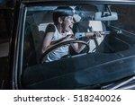 Young Boy Driving A Car At...