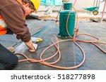 roofer installing rolls of... | Shutterstock . vector #518277898