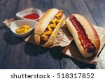 tasty hot dogs on paper on... | Shutterstock . vector #518317852
