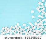 Marshmallows On Blue Backgroun...