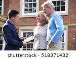 realtor showing mature couple... | Shutterstock . vector #518371432