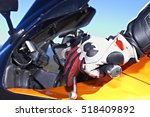 Small photo of Motorcycle with hand on the accelerator