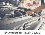 mechanic open the cover of... | Shutterstock . vector #518421232