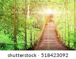 suspension bridge in forest at... | Shutterstock . vector #518423092