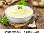 Small photo of Potato Mash on rustic wooden background (close-up shot)
