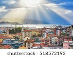 Small photo of Scenic aerial view of La Spezia and Gulf of Spezia with dramatic morning sky and light beams at sunrise. Liguria, Italy