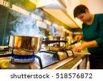 woman preparing food in kitchen | Shutterstock . vector #518576872