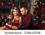 husband gives his wife a gift... | Shutterstock . vector #518610538