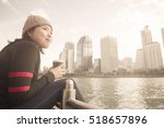 young woman holding cup of...   Shutterstock . vector #518657896