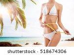 sexy girl measuring perfect... | Shutterstock . vector #518674306