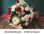 Stock photo stylish bouquet of red and green colors on a dark green background bouquet of brassica rose and 518721622