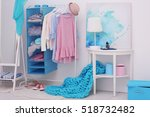 fashionable clothes hanging on... | Shutterstock . vector #518732482