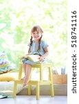 cute little girl with book... | Shutterstock . vector #518741116
