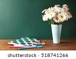 copybooks and flowers on... | Shutterstock . vector #518741266