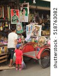 Small photo of Tak Province, Thailand - November 15, 2011 : People of Myanmar shopping in the market of Mae Sot, storefront hang the posters of Mrs. Aung San Suu Kyi