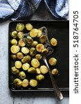 roasted brussels sprouts on a... | Shutterstock . vector #518764705