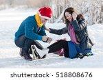 happy couple having fun ice... | Shutterstock . vector #518808676