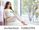 young beautiful pregnant woman...   Shutterstock . vector #518822596