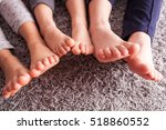 cute kids foot together on gray ... | Shutterstock . vector #518860552