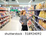 woman shopping in supermarket... | Shutterstock . vector #518924092