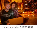 young couple looking on laptop... | Shutterstock . vector #518935252