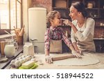 beautiful young mom and her... | Shutterstock . vector #518944522