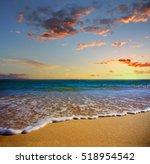 sand and foam . beach at sunset ... | Shutterstock . vector #518954542