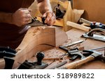 carpenter works with a planer... | Shutterstock . vector #518989822