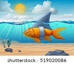 golden fish wearing a shark fin.... | Shutterstock . vector #519020086