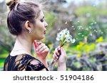 teen pretty girl blowing on... | Shutterstock . vector #51904186