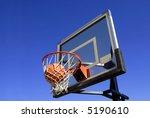 Action shot of basketball going through basketball hoop and net - stock photo