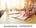 hand with pencil and notebook... | Shutterstock . vector #519065092