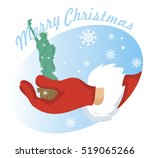 hand santa with statue of... | Shutterstock .eps vector #519065266