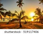 sunset on the beach of... | Shutterstock . vector #519117406