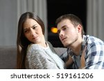 Stock photo insistent man trying to get sex and his worried girlfriend denying on a couch in the night at home 519161206