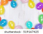 rainbow ballon on the wooden...   Shutterstock . vector #519167425