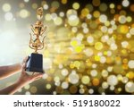 win concept man holding up a... | Shutterstock . vector #519180022