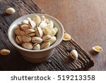 roasted in shell pistachios in... | Shutterstock . vector #519213358