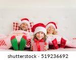 Family In Christmas Santa Hats...