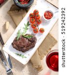 the steak from beef is served... | Shutterstock . vector #519242392