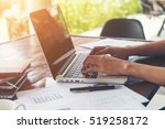 business woman hand typing on... | Shutterstock . vector #519258172
