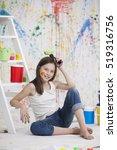 girl on floor with painted... | Shutterstock . vector #519316756