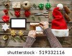 man wraps christmas gift. human ... | Shutterstock . vector #519332116