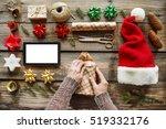 man wraps christmas gift. human ... | Shutterstock . vector #519332176