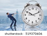 businessman pulling clock in... | Shutterstock . vector #519370606