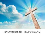 wood cross on blue sky.... | Shutterstock . vector #519396142