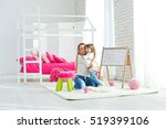 child plays with mother | Shutterstock . vector #519399106