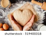 female hands holding dough in... | Shutterstock . vector #519400318